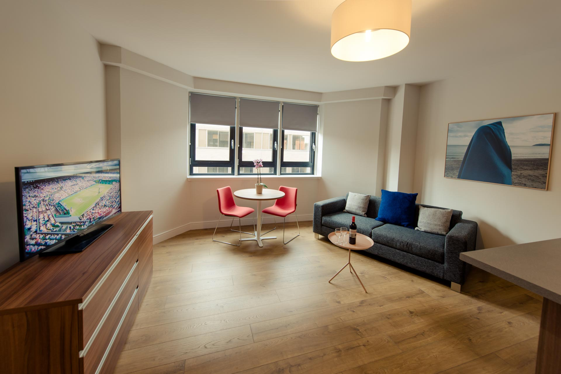 Living area of a bright two bedroom apartment PREMIER SUITES PLUS Glasgow Bath Street