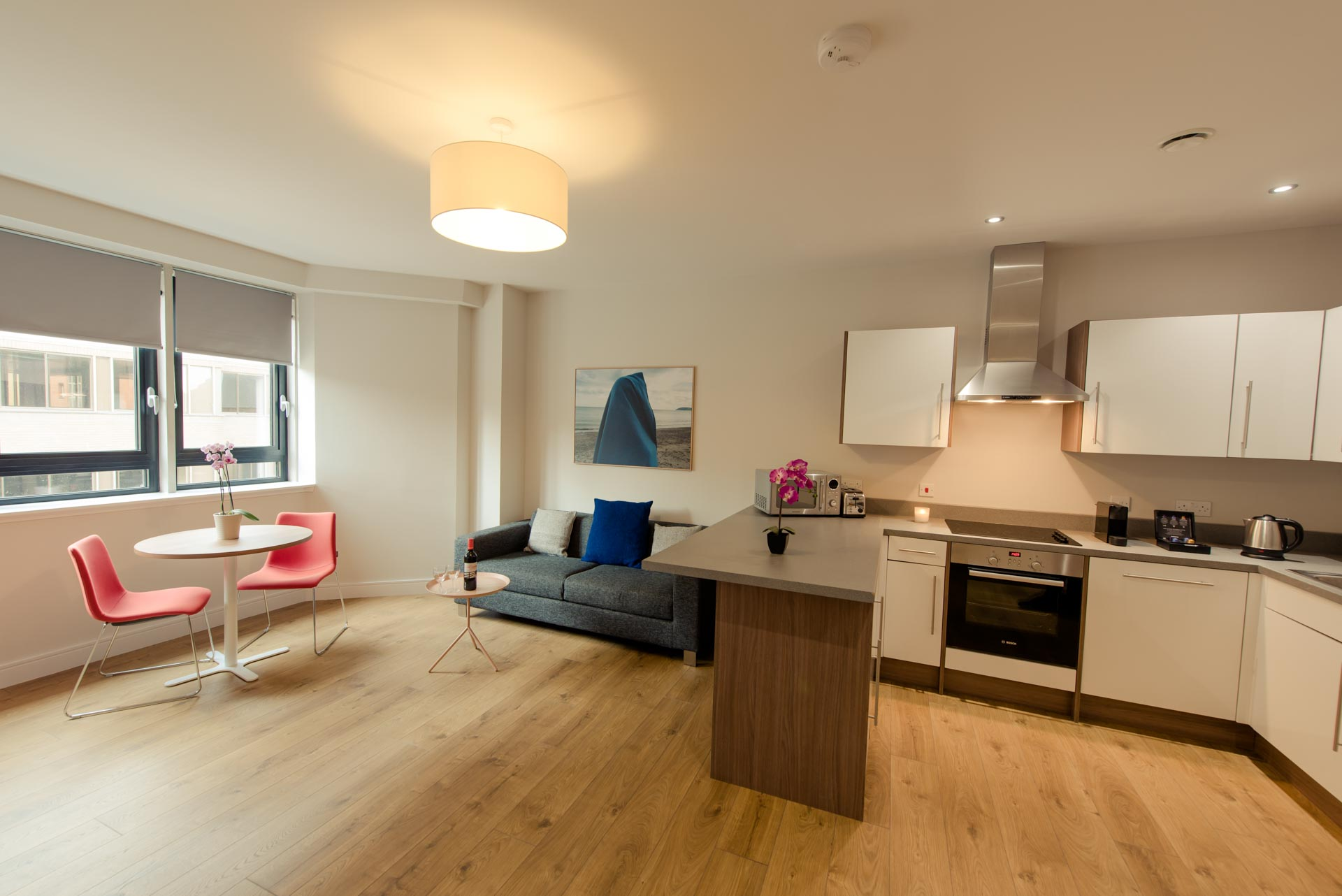 Kitchen and living area of bright one bed apartment PREMIER SUITES PLUS Glasgow Bath Street
