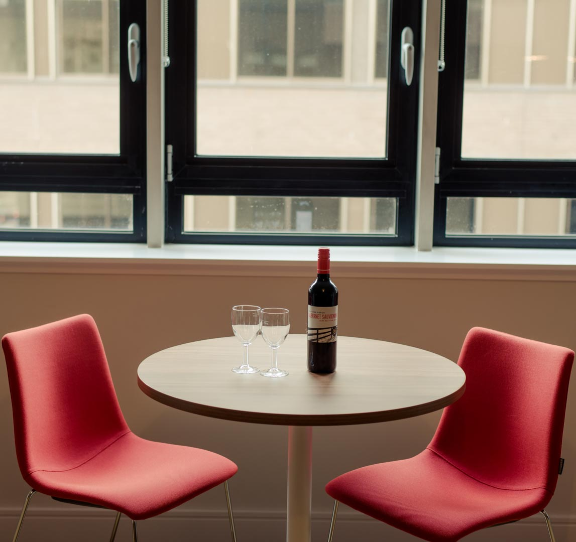Bottle of red wine on a table in PREMIER SUITES PLUS Glasgow Bath Street