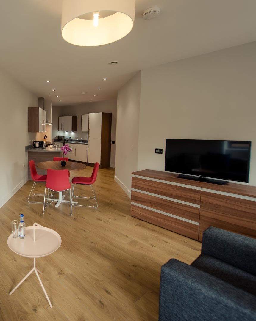 Living and dining area of a two bed apartment PREMIER SUITES PLUS Glasgow Bath Street